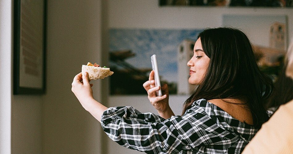 Social Media Influencer Taking Photo of Pizza