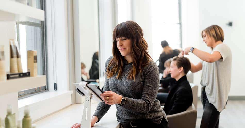 Salon Owner looking at iPad
